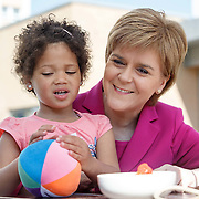 First Minister Nicola Sturgeon at Townhead Village Hall in Glasgow having a picnic with families. With Somaya Tolland (4) from Glasgow. Picture Robert Perry 1st June 2016<br /> <br /> Must credit photo to Robert Perry<br /> FEE PAYABLE FOR REPRO USE<br /> FEE PAYABLE FOR ALL INTERNET USE<br /> www.robertperry.co.uk<br /> NB -This image is not to be distributed without the prior consent of the copyright holder.<br /> in using this image you agree to abide by terms and conditions as stated in this caption.<br /> All monies payable to Robert Perry<br /> <br /> (PLEASE DO NOT REMOVE THIS CAPTION)<br /> This image is intended for Editorial use (e.g. news). Any commercial or promotional use requires additional clearance. <br /> Copyright 2014 All rights protected.<br /> first use only<br /> contact details<br /> Robert Perry     <br /> 07702 631 477<br /> robertperryphotos@gmail.com<br /> no internet usage without prior consent.         <br /> Robert Perry reserves the right to pursue unauthorised use of this image . If you violate my intellectual property you may be liable for  damages, loss of income, and profits you derive from the use of this image.