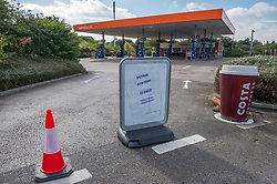 © Licensed to London News Pictures; 25/09/2021; Bristol, UK. Signs saying the filling station is closed are seen at Sainsbury's in Emersons Green. The UK has a fuel crisis with shortages at filling stations caused by a lack of HGV lorry drivers to deliver fuel, and from people panic buying and queueing for petrol. Photo credit: Simon Chapman/LNP.