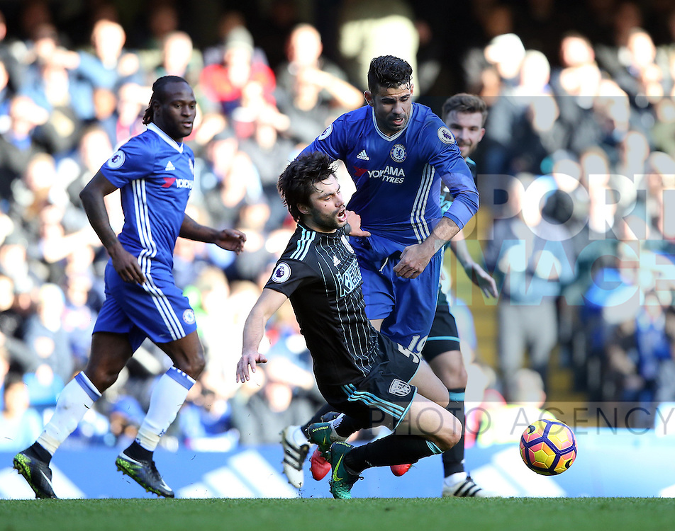 Chelsea's Diego Costa tussles with WBA's Claudio Jacob during the Premier League match at Stamford Bridge Stadium, London. Picture date December 11th, 2016 Pic David Klein/Sportimage