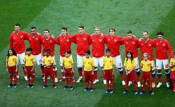 Russia's Fyodor Smolov (left to right) Aleksandr Samedov, Alan Dzagoev, Ilya Kutepov, Aleksandr Golovin, Yury Gazinsky, Mario Fernandes, Roman Zobnin,  Sergei Ignashevich, Yuri Zhirkov (right) during the national anthem
