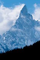 The Aiguille Noire de Peuterey (Mont Blanc Massif) pierces the sky above Courmayeur, Italy.