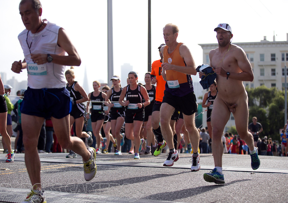 A naked man crests the Hayes Street hill during the 103rd running of the Bay to Breakers 12K race, Sunday, May 18, 2014 in San Francisco. (Photo by D. Ross Cameron)