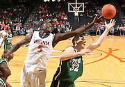 Nov. 15, 2010; Charlottesville, VA, USA; Virginia Cavaliers center Assane Sene (5) fights for a rebound with USC Upstate Spartans forward Chalmers Rogers (32) during the game at the John Paul Jones Arena. Virginia won 74-54. Photo/