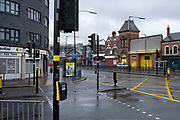Street scene on High Street Deritend in Digbeth in Birmingham city centre, which is virtually deserted under Coronavirus lockdown on a wet rainy afternoon on 28th April 2020 in Birmingham, England, United Kingdom. Britains second city has been in a state of redevelopment for some years now, but with many outdated architectural remnants still remaining, on a grey day, the urban landscape appears as if frozen in time. Coronavirus or Covid-19 is a new respiratory illness that has not previously been seen in humans. While much or Europe has been placed into lockdown, the UK government has put in place more stringent rules as part of their long term strategy, and in particular social distancing.