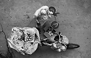 25th July 2014, New Delhi, India. An overhead shot of a man selling fruit from a bicycle door-to-door in Jangpura, New Delhi, India on the 25th July 2014<br /> <br /> PHOTOGRAPH BY AND COPYRIGHT OF SIMON DE TREY-WHITE<br /> <br /> + 91 98103 99809<br /> email: simon@simondetreywhite.com