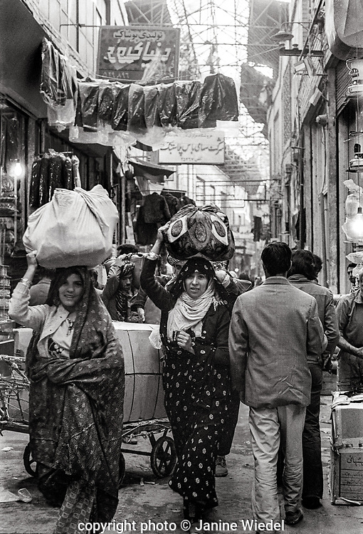 Traders and women carrying heavy loads in Grand Bazaar in Tehran  Iranhijabs