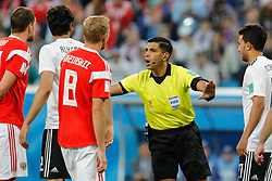 June 19, 2018 - Saint Petersburg, Russia - Referee Enrique Caceres (C) talks to players during the 2018 FIFA World Cup Russia group A match between Russia and Egypt on June 19, 2018 at Saint Petersburg Stadium in Saint Petersburg, Russia. (Credit Image: © Mike Kireev/NurPhoto via ZUMA Press)