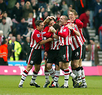 Fotball<br /> FA-cup 2005<br /> Southampton v Portsmouth<br /> 29. januar 2005<br /> Foto: Digitalsport<br /> NORWAY ONLY<br /> Southampton players mob Matt Oakley after he opened the scoring for Saints