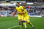 Alex Mowatt of Leeds united (l) celebrates with Gaetano Berardi (28)  after scoring his teams 3rd goal. Skybet football league Championship match, Huddersfield Town v Leeds United at the John Smith's Stadium in Huddersfield, Yorks on Saturday 7th November 2015.<br /> pic by Chris Stading, Andrew Orchard sports photography.