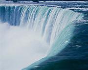 The Niagara River spilling over Horseshoe Falls, Niagara Falls, Ontario, Canada.