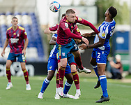 Bristol Rovers defender Mark Little (2) and Bristol Rovers Brandan Halan both compete for the ball against Ipswich Town forward Freddie Sears (20) during the EFL Sky Bet League 1 match between Bristol Rovers and Ipswich Town at the Memorial Stadium, Bristol, England on 19 September 2020.