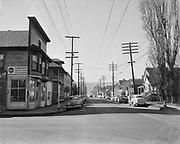Y-510222-03. Slum area. NW 21st & Thurman looking west. February 22, 1951