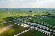 Nederland, Overijssel, Gemeente Kampen, 27-08-2013. Hanzelijn met Station Kampen Zuid, stadsdeel Kampen-Zuid. Parallel aan de spoorlijn de N50. Ontwerp van architect Tjerk van de Lune (StudioSK). <br /> Railway station at the new railway Hanzelijn, near Kampen.<br /> luchtfoto (toeslag op standaard tarieven);<br /> aerial photo (additional fee required);<br /> copyright foto/photo Siebe Swart.