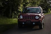 USA, Oregon, Willamette Mission State Park, Jeep Patriot driving in the park. MR, PR