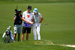 May 2, 2019 - Charlotte, NC, U.S. - CHARLOTTE, NC - MAY 02: Rickie Fowler goes over his caddies notes on the 5th hole during round one of the Wells Fargo Championship on March 02, 2019 at Quail Hollow Club in Charlotte,NC. (Photo by Dannie Walls/Icon Sportswire) (Credit Image: © Dannie Walls/Icon SMI via ZUMA Press)