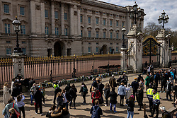 © Licensed to London News Pictures. 09/04/2021. London, UK. Mourners leave flowers outside Buckingham Palace after the death of Prince Philip. The Duke of Edinburgh Prince Philip, Queen Elizabeth II's husband, has died aged 99 Buckingham Palace has announced. Photo credit: Rob Pinney/LNP