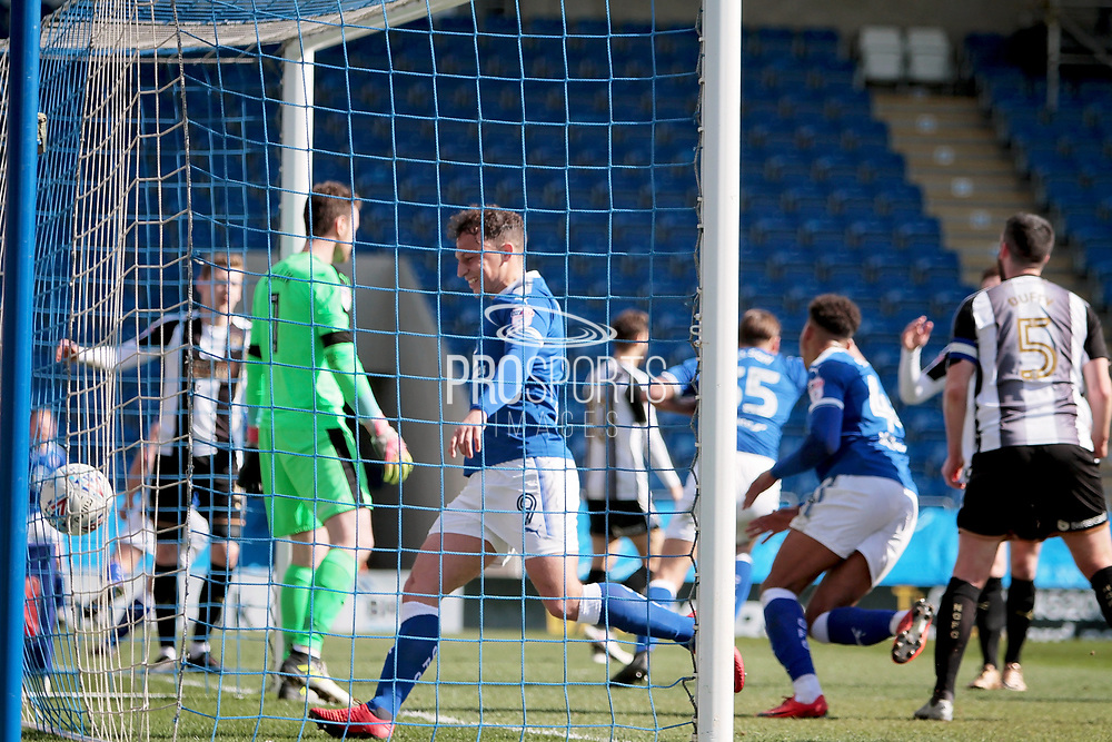 Chesterfield forward Kristian Dennis (9)  celebrates the first goal by Chesterfield defender Sid Nelson (35)  the EFL Sky Bet League 2 match between Chesterfield and Notts County at the Proact stadium, Chesterfield, England on 25 March 2018. Picture by Nigel Cole.