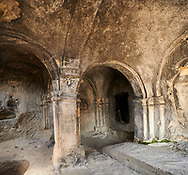 Picture & image of the interior of the one pillar hall Uplistsikhe (Lords Fortress) troglodyte cave city, near Gori, Shida Kartli, Georgia. UNESCO World Heritage Tentative List<br /> <br /> Inhabited from the early Iron age to the late middle ages Uplistsikhe cave city eas, during the Roman & Hellenistic period, home to around 20,000 people. .<br /> <br /> Visit our MEDIEVAL PHOTO COLLECTIONS for more   photos  to download or buy as prints https://funkystock.photoshelter.com/gallery-collection/Medieval-Middle-Ages-Historic-Places-Arcaeological-Sites-Pictures-Images-of/C0000B5ZA54_WD0s<br /> <br /> Visit our REPUBLIC of GEORGIA HISTORIC PLACES PHOTO COLLECTIONS for more photos to browse, download or buy as wall art prints https://funkystock.photoshelter.com/gallery-collection/Pictures-Images-of-Georgia-Country-Historic-Landmark-Places-Museum-Antiquities/C0000c1oD9eVkh9c