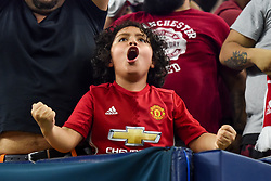 A young Manchester United fan excited during the International Champions Cup match between Manchester United and Manchester City at NRG Stadium in Houston, Texas