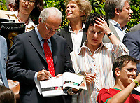 Photo: Glyn Thomas.<br /> Portugal v Iran. Group D, FIFA World Cup 2006. 17/06/2006.<br /> <br /> Franz Beckenbauer (L) signs an autograph for the German Justice Minister (Bundesministerin der Justitz) Brigitte Zypries who are both in Frankfurt to watch the match between Portugal and Iran.