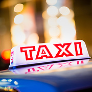 Taxi at night on Canton Road, Tsim Sha Tsui, Hong Kong
