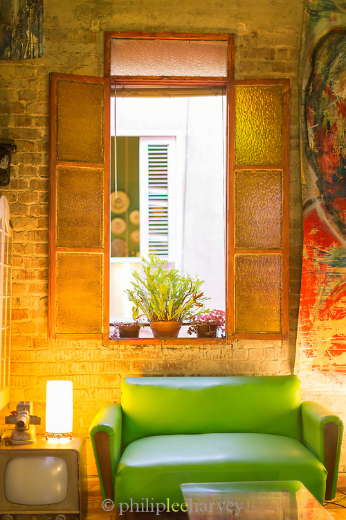 Cafe with green sofa with old-fashioned equipment, Havana, Cuba