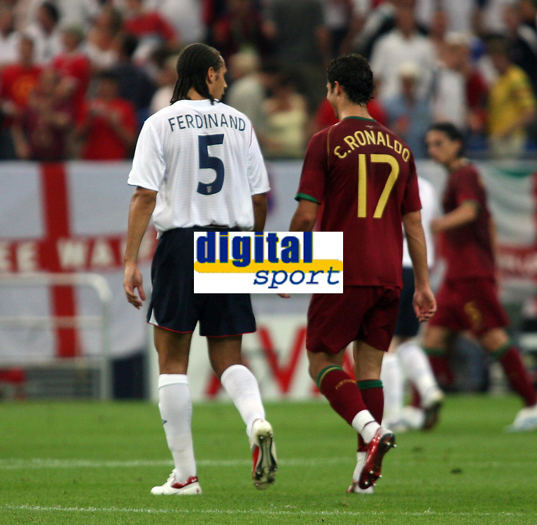 Photo: Chris Ratcliffe.<br /> England v Portugal. Quarter Finals, FIFA World Cup 2006. 01/07/2006.<br /> Cristiano Ronaldo of Portugal chats with Rio Ferdinand at half time.