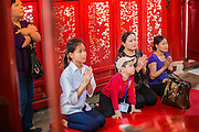 02 APRIL 2012 - HANOI, VIETNAM: Vietnamese pray in Ngoc Son Temple, which was reportedly built during the Tran Dynasty (ca 1225) in the Old Quarter of Hanoi, Vietnam. The temple is dedicated to Tran Hung Dao, a Vietnamese national hero who defeated an invading Mongol army in the 13th century.    PHOTO BY JACK KURTZ