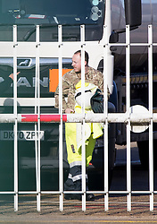 © Licensed to London News Pictures. 05/10/2021. Hemel Hempstead, UK. A member of the military is seen getting out of a fuel tanker at Buncefield oil depot in Hemel Hempstead, Hertfordshire. Military personnel have started helping with driver shortages following more than a week of long queues and closures at petrol stations. Photo credit: Ben Cawthra/LNP