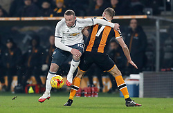 Manchester United's Wayne Rooney (left) and Hull City's David Meyler battle for the ball during the EFL Cup Semi Final, Second Leg match at the KCOM Stadium, Hull.