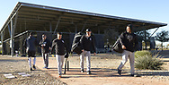 GLENDALE, ARIZONA - FEBRUARY 19: Members of the Chicago White Sox walk toward the clubhouse during spring training workouts on February 19, 2019 at Camelback Ranch in Glendale Arizona.  (Photo by Ron Vesely/MLB Photos via Getty Images)