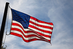 American Flag waving proudly against the sky