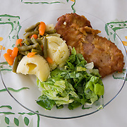 Kotlet  Schabowy - Pork cutlet <br /> Serves 50<br /> <br /> Ingredients:5 Kg pork<br /> 16 eggs<br /> 200gr flour<br /> 500gr dried bread rolls <br /> 600gr vegetable oil<br /> 15gr salt <br /> 10gr black pepper <br /> 20gr Vegeta (Vegetable extract) <br /> <br /> Preparation :<br /> 1.Clean the meat and cut it in thin slices <br /> 2.Tenderise the meat <br /> 3.In a bowl mix the eggs with the flour<br /> 4.Spread the meat and sprinkle with salt, pepper and Vegeta<br /> 5.Put oil in a pan and warm it until very hot<br /> 6.Batter the meat and fry for about 15min <br /> <br /> <br /> Mashed potatoes <br /> Serves 50<br /> <br /> Ingredients:15 Kg potatoes<br /> 250gr butter <br /> 30gr salt<br /> 1 large bunch of dill <br /> <br /> Preparation :<br /> 1.Peel the potatoes<br /> 2.Put the potatoes in a large saucepan<br /> 3.Add water and salt<br /> 4.Bring to boil <br /> 5.Boil until soft and then drain<br /> 6.Mash the potatoes adding a cube of butter<br /> 7.Sprinkle finely chopped dill and serve <br /> <br /> <br /> <br /> Green Salad<br /> Serves 50<br /> <br /> Ingredients:10 lettuces <br /> 125ml olive oil<br /> 5gr salt<br /> juice of one lemon<br /> sugar <br /> <br /> Preparation :<br /> 1.Wash the lettuce and separate the leafs<br /> 2.Put the lettuce into a big bowl <br /> 3.Prepare the sauce and add sugar on taste <br /> 4.Add the sauce on the salad before serving  <br /> <br /> <br /> Boiled carrots <br /> Serves 50<br /> <br /> Ingredients:5 Kg carrots<br /> 5gr salt<br />  <br /> <br /> Preparation :<br /> 1.Peel the carrots and put them in hot boiling water <br /> 2.Boil until soft  <br /> 3.When ready cut in cubes <br /> 4.Add butter and 3 spoons of flour<br /> 5.Mix and bring to boil<br /> 6.Leave it to cool before serving<br /> <br /> <br /> Green Beans<br /> Serves 50<br /> <br /> Ingredients:2 Kg green beans<br /> 5gr salt<br />  <br /> <br /> Preparation :<br /> 1.In a large pot boil water <br /> 2.Add the frozen beans<br /> 3.Boil until soft<br