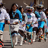 Tenley Crowder, center, and other members of the seventh grade class perform a deer dance during the Indigenous Peoples' Day celebration at Six Directions School in Gallup Monday.