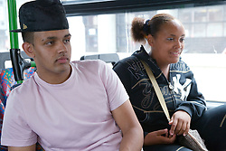 Two teenagers travelling on public transport,