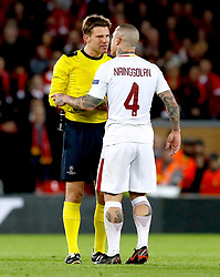 AS Roma's Radja Nainggolan exchanges words with Referee Felix Brych