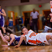 120713       Cable Hoover<br /> <br /> Gallup Bengal Kaylee Tsinigine (12) timbales over Clovis Wildcat Brandi Gomez (2) as they chase a loose ball during the final of the Gallup Invitational Saturday at Gallup High School.