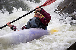 Diane McHenry of Ironton, Missouri races in the women's boatercross class during the 42nd Annual Missouri Whitewater Championships. McHenry placed third place in the class. The Missouri Whitewater Championships, held on the St. Francis River at the Millstream Gardens Conservation Area, is the oldest regional slalom race in the United States.