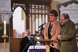© Licensed to London News Pictures.  17/11/2013. THAME, UK. Joanne Parker (L) reads the poem A Child of Mine by Edgar Guest during the annual Road Deaths Memorial Service held in St Marys Church, Thame.  78 people were killed in traffic accidents in the Thames Valley Police area last year.  Photo credit: Cliff Hide/LNP