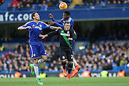 Baba Rahman of Chelsea jumps over Xherdan Shaqiri of Stoke City for the ball with Nemanja Matic of Chelsea (l) looking on.. Barclays Premier league match, Chelsea v Stoke city at Stamford Bridge in London on Saturday 5th March 2016.<br /> pic by John Patrick Fletcher, Andrew Orchard sports photography.