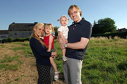 GROOT BIJGAARDEN, BELGIUM - JULY-17-2006 - Sherry Sharff, her husband Nicholas and their children Sloane, 2 1/2 years-old, and Nayah, 15 months-old, stand on their newly purchased land, where they will break ground for the construction of their new home in November. (PHOTO © JOCK FISTICK)
