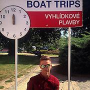 A young man selling boat trips. #prag #praha #prague #czechrepublic #tourism #boat #portrait #glasses #green #moldau #vltava #public #street