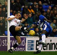 Photo: Jo Caird<br /> Reading v Derby<br /> Madejski Stadium<br /> Nationwide Div 1 2004<br /> 31/01/2004.<br /> <br /> MIcheal Johnson v readings Shaun Goater