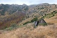 Abandoned summer cottages (katuni) at Katun Sarkinovica, just below the 2,210m south summit of Visitor, a mountain near Plav, Montenegro. © Rudolf Abraham
