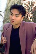 Korean man age 24 deep in thought.  St Paul Minnesota USA
