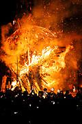Burning wooden constructions at night, Nozawaonsen, Japan