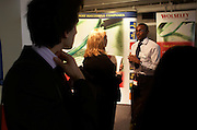 Straightening one's tie at a graduate expo fair where company job recruiters meet young people starting work