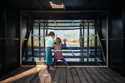 Two children are playing at a periscope, a social artistic project setup at the oude dokken of ghent, Belgium, 11.10.2015