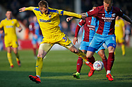 Wimbledon forward Joe Pigott (39) contest a loose ball with Scunthorpe United defender Byron Webster(5)  during the EFL Sky Bet League 1 match between Scunthorpe United and AFC Wimbledon at Glanford Park, Scunthorpe, England on 30 March 2019.