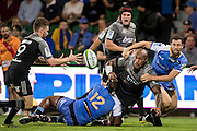 Nemani Nadolo of the BNZ Crusaders off loads a pass in a tackle during the Canterbury Crusaders v the Western Force Super Rugby Match. Nib Stadium, Perth, Western Australia, 8th April 2016. Copyright Image: Daniel Carson / www.photosport.nz